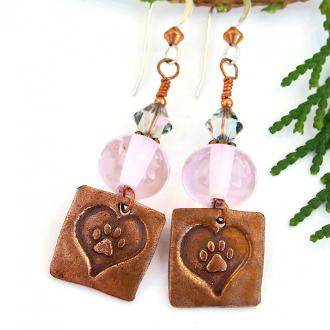 One of a kind dog rescue earrings with copper paw print and hearts charms.
