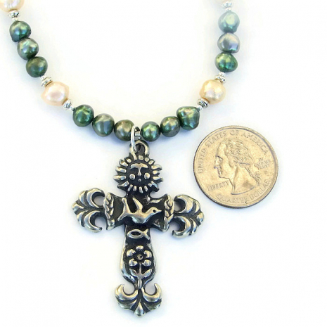 Earth cross necklace with pearls.