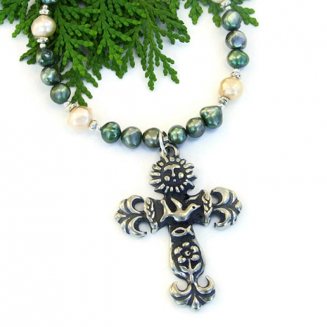 Meaningful earth cross necklace.