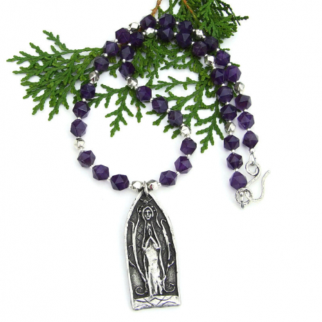 medieval church window praying figure pendant necklace with star cut amethyst