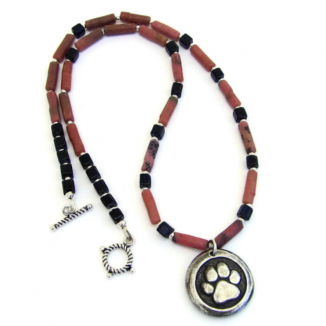 Dog paw print and gemstone necklace.