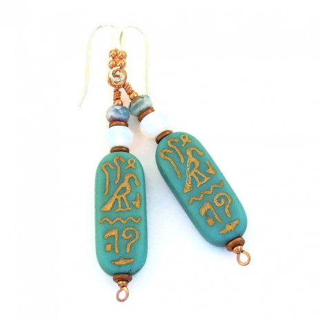 Unique handmade earrings created with turquoise Czech glass hieroglyph beads.