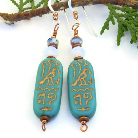 One of a kind cartouche hieroglyph handmade earrings with a falcon symbol.