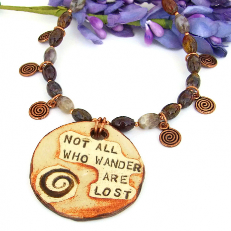 Not All Who Wander Are Lost handmade boho necklace with spirals.