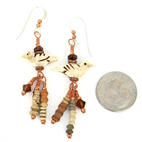 One of a kind bird earrings for her.