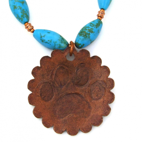 patinated back side of dog paw print pendant