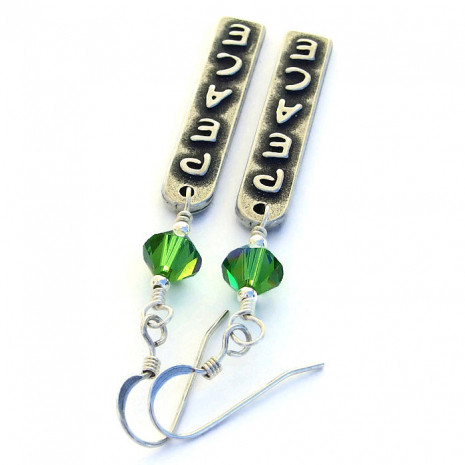 Peace word earrings with green Swarovski crystals.