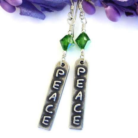 One of a kind peace earrings with fern green crystals.