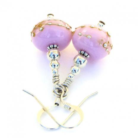 Unique artisan handmade bubblegum pink lampwork glass and silver earrings.