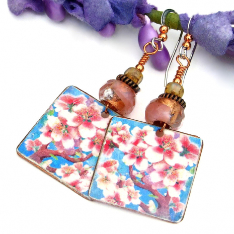 pink cherry blossoms against blue sky jewelry