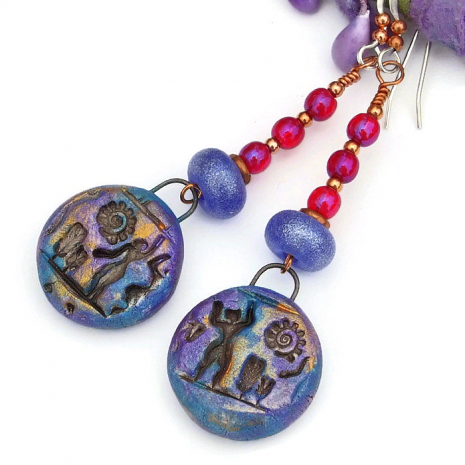 polymer clay people and spiraling sun hieroglyph earrings