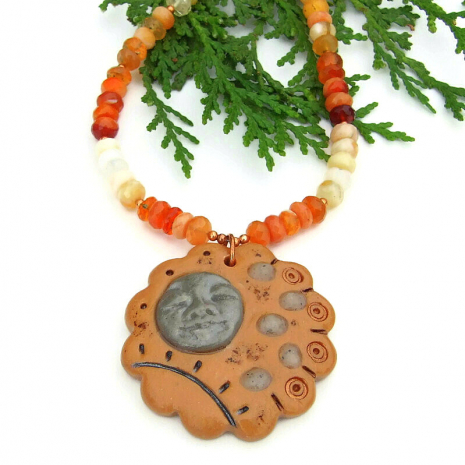 polymer clay stepping stone with face pendant jewelry