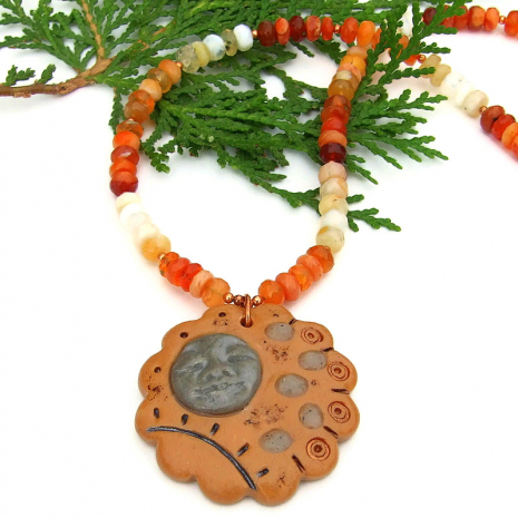 polymer clay stepping stone with face pendant necklace