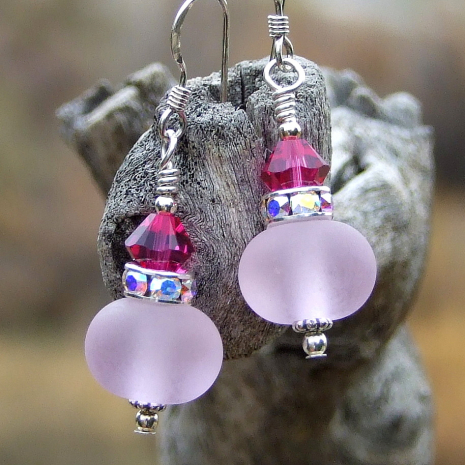 Pale pink and fuchsia designer earrings.