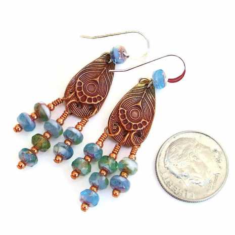 Boho chandelier style peacock feather charm earrings with Czech glass dangles.
