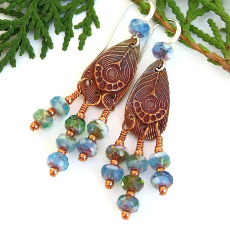 Stunning handmade earrings featuring artisan made copper peacock feather charms.