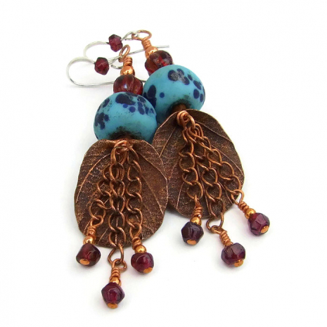 Handmade leaf earrings with turquoise lampwork glass beads.