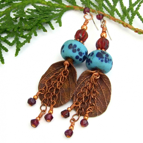 Copper, lampwork and garnet leaf earrings.