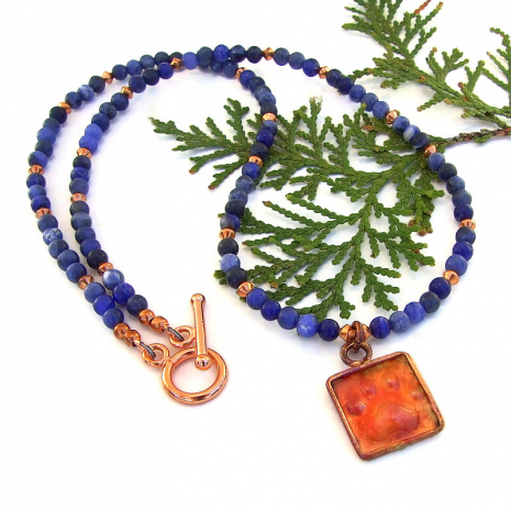 red copper dog paw print pendant necklace with blue sodalite