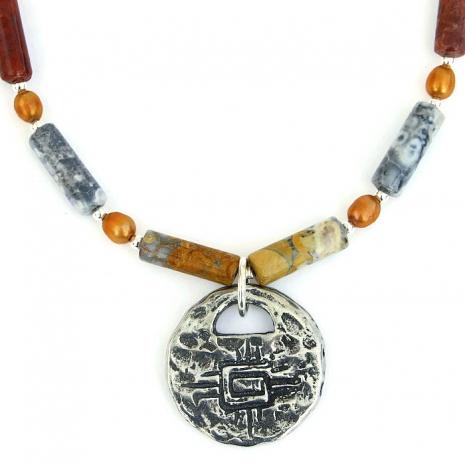 Handmade petroglyph horses necklace.