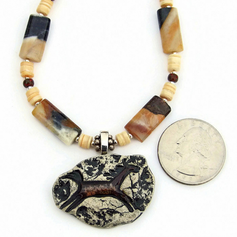 One of a kind horse petroglyph necklace with amazonite and shell.