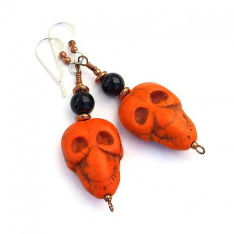 Orange and black skull earrings for Halloween.