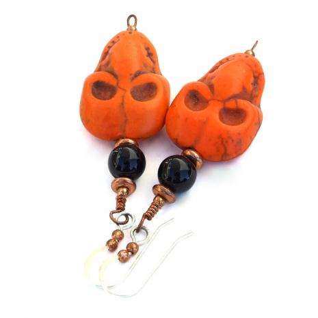 Orange skull earrings for women.