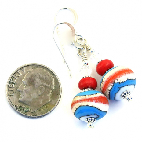 Handmade coral red, turquoise blue and ivory Southwest colored dangle earrings.