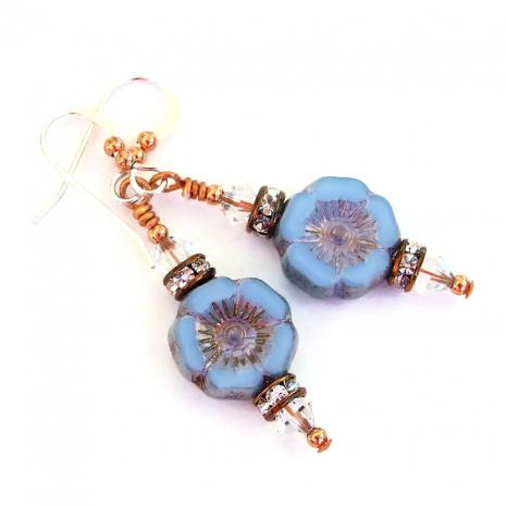 Artisan handmade blue pansy flower earrings.