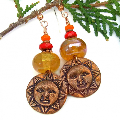 Sun face earrings.
