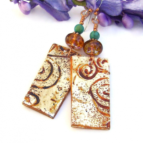 southwest inspired polymer clay spiral earrings with lampwork and turquoise