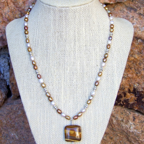 Petrified wood pendant and pearl necklace for women.