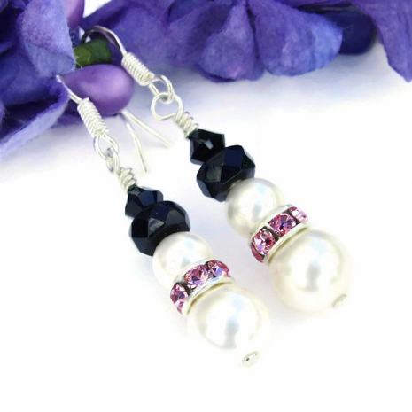 Breast cancer survivor snowmen earrings.