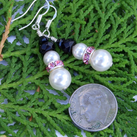 White, pink and black breast cancer survivor snowmen earrings.