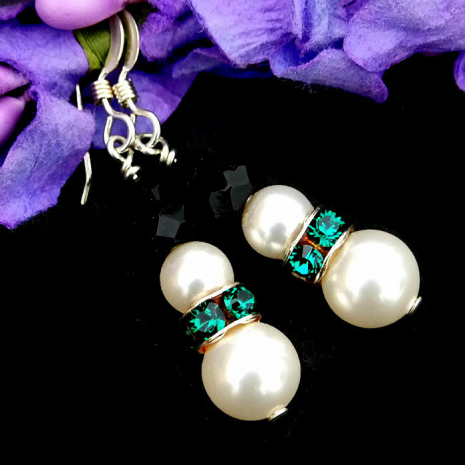 Glowing Swarovski pearl snowmen earrings with green crystal collars.