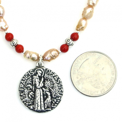One of a kind St Francis pendant necklace with pearls and coral.