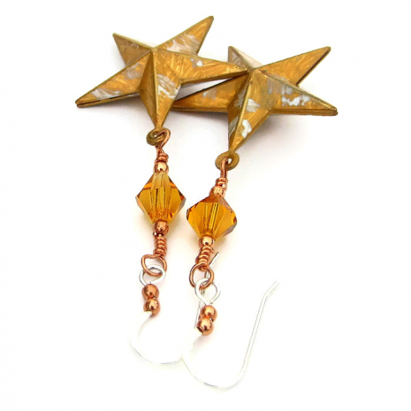 Golden Texas star earrings for her.