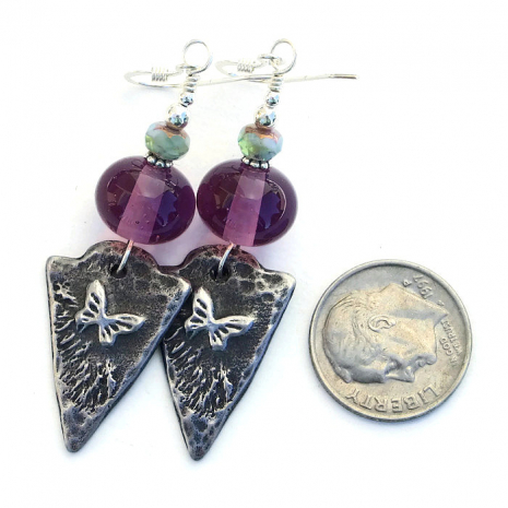Handmade butterfly and purple lampwork earrings.
