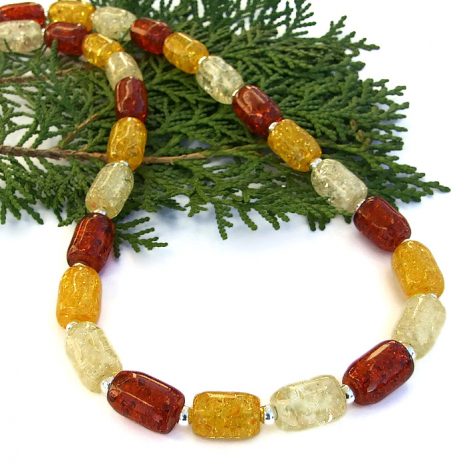 Beautiful, one of a kind pressed amber necklace in three glowing colors.
