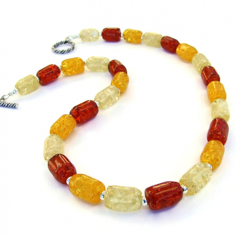 Unique handmade necklace featuring pressed amber barrels and sterling silver.