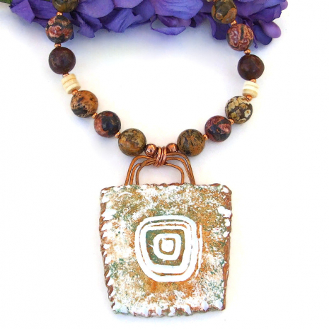 sun petroglyph pendant necklace with leopardskin jasper gemstones