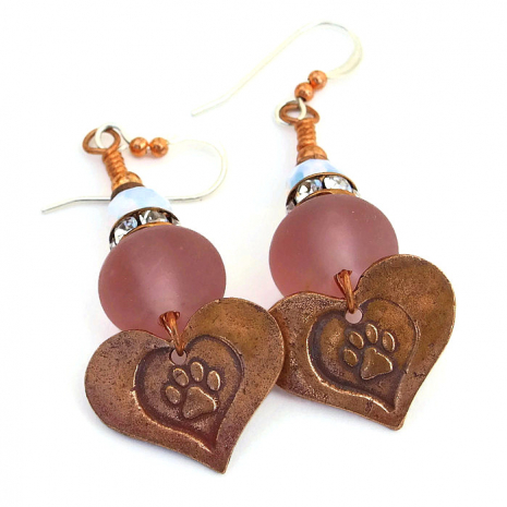 Handmade dog rescue earrings with hearts and paw prints.
