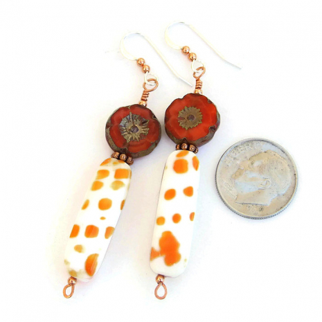 Beautiful orange and white shell earrings with orange Czech glass flower beads.