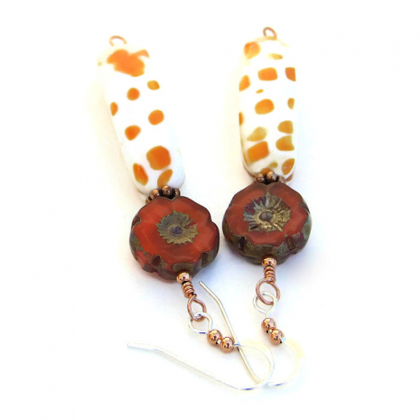 One of a kind summery orange and white mitra shell and pansy flower earrings.