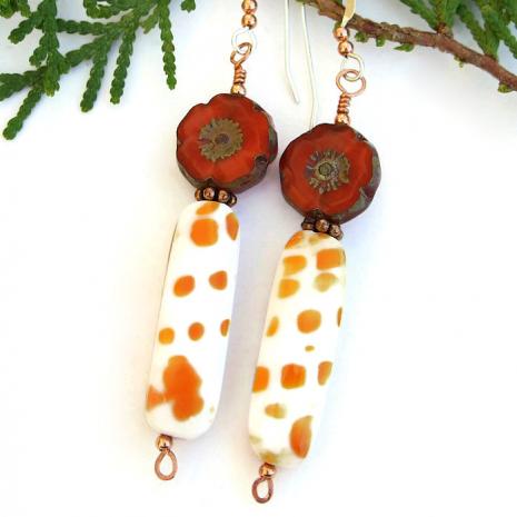 Unique orange and white mitra shell and orange flower dangle jewelry.