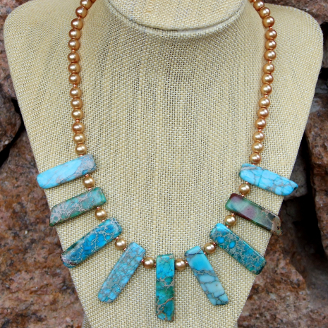 Aqua and gold stick collar necklace.