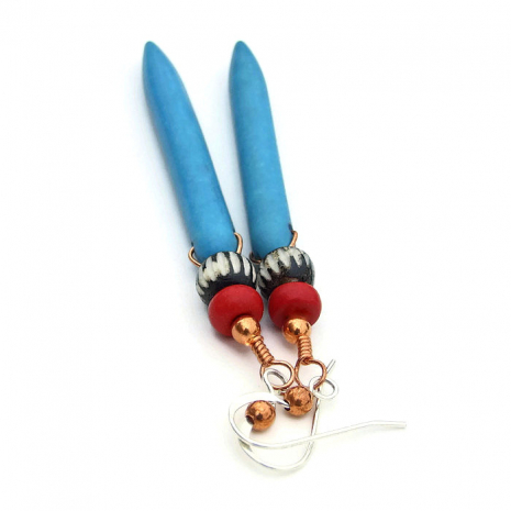 One of a kind turquoise magnesite spike earrings with carved bone beads.