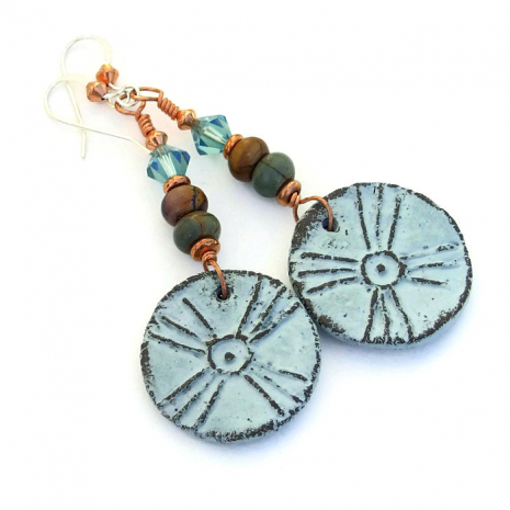 Cross sun earrings.