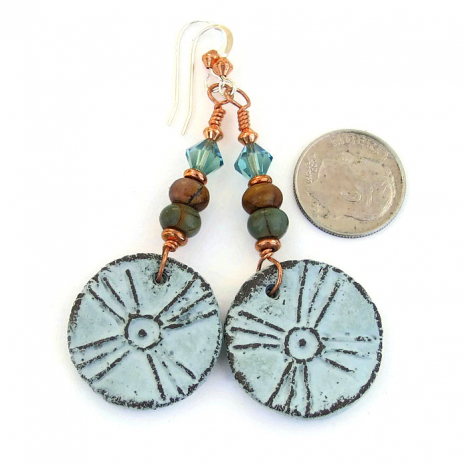 Ancient looking tribal sun cross earrings.