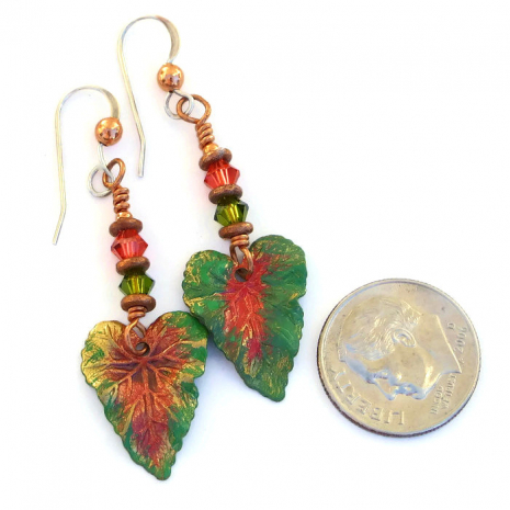 One of a kind hand painted tropical leaf earrings.